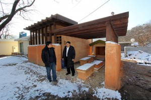 Kim Soonwung and Dr. Heyzoo Hwang in front of the demonstration building built by students December 2013
